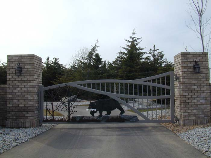 ... Large Brick Columns Are Used To Accent This Gate